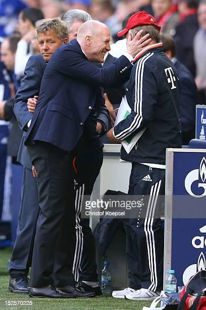 Sporting director Matthias Sammer and assistant coach Hermann Gerland celebrate after winning 20 the Bundesliga match between FC Schalke 04 and FC...