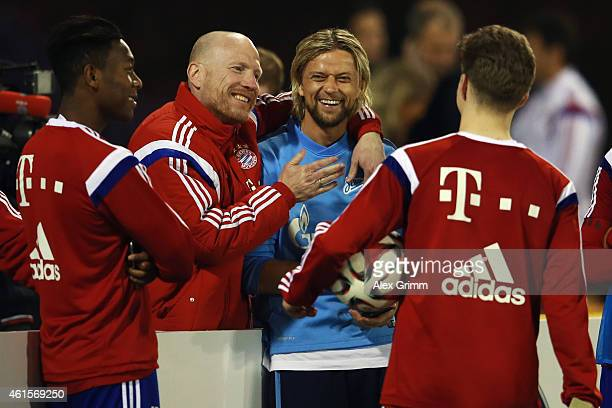 Sporting director Matthias Sammer hugs Anatolyi Tymoshchuk of Zenit during day 7 of the Bayern Muenchen training camp at ASPIRE Academy for Sports...