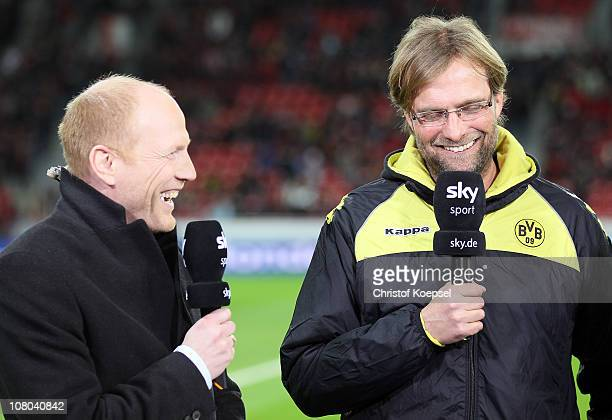 Sporting director Matthias Sammer of the DFB and head coach Juergen Klopp of Dortmund talk prior to the Bundesliga match between Bayer Leverkusen and...