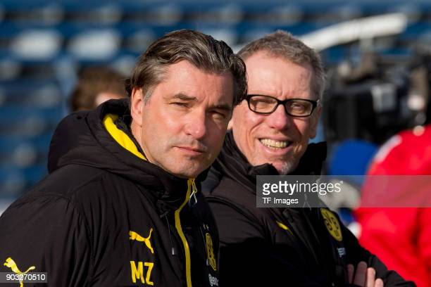 Sporting director Michael Zorc of Dortmund looks on and Head coach Peter Stoeger of Dortmund laughs during the Friendly match between Borussia...
