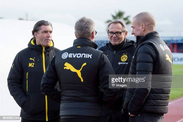 Sporting director Michael Zorc of Dortmund speaks with Head coach Peter Stoeger of Dortmund Sociologist Werner Zoechling of Dortmund and Director of...