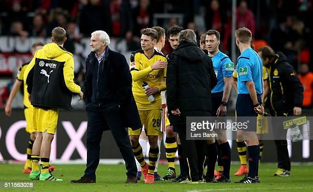 Sporting director of Leverkusen Rudi Voeller is seen with referee Felix Zwayer after the Bundesliga match between Bayer Leverkusen and Borussia...