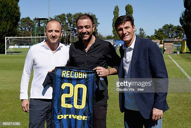 Sporting Director Piero Ausilio Alvaro Recoba and vice president Javier Zanetti pose for a photo during the FC Internazionale training session at the...