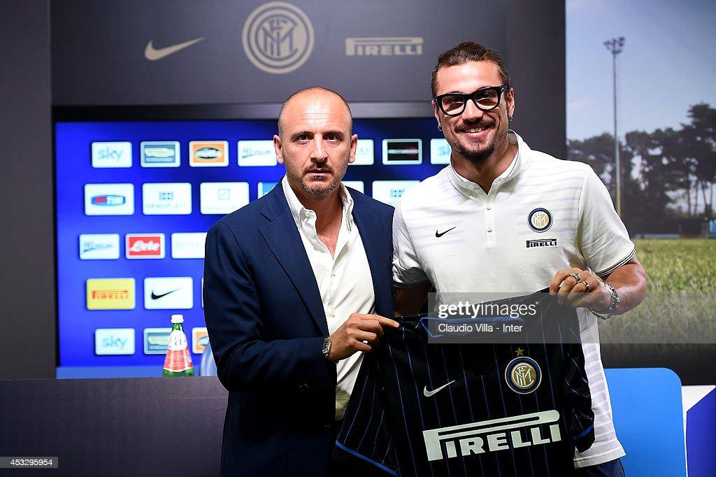 Sporting Director Piero Ausilio (L) and new signing Pablo Daniel Osvaldo attend FC Internazionale Milano press conference on August 7, 2014 in Como, Italy.