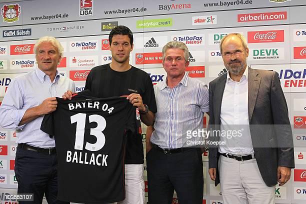 Sporting director Rudi Voeller Michael Ballack head coach Jupp Heynckes and chairman Wolfgang Holzhaeuser present the jersey of Michael Ballack...