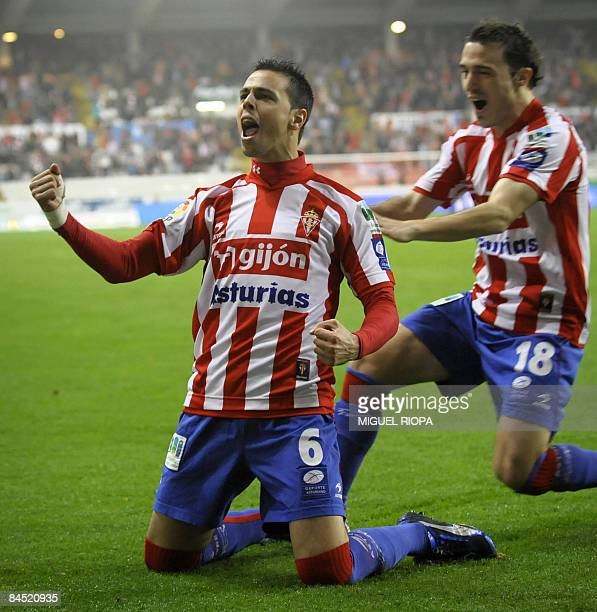 Sporting Gijon's Carmelo Gonzalez celebrates after scoring against Athletic Bilbao with teammate Luis Moran during their Spanish King´s Cup quarter...