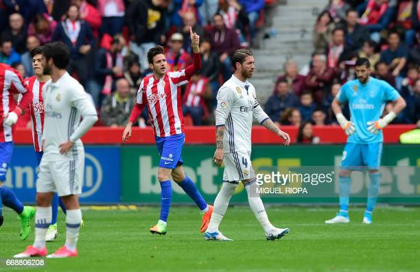 Sporting Gijon's Croatian forward Duje Cop celebrates after scoring a goal during the Spanish league football match Real Sporting de Gijon vs Real...
