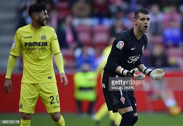 Sporting Gijon's goalkeeper Ivan Cuellar gestures after a second goal scored by Villarreal's Italian forward Nicola Sansone during the Spanish league...