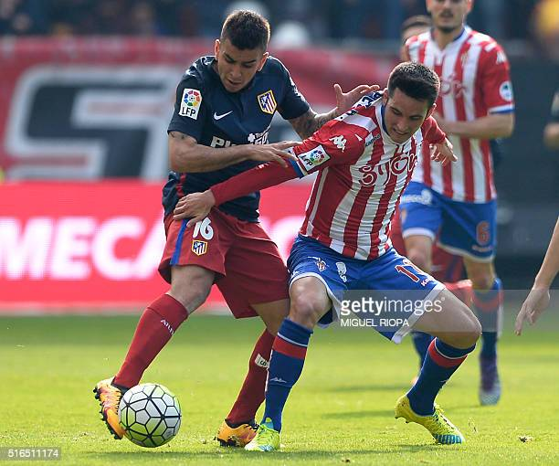 Sporting Gijon's midfielder Omar Mascarell vies with Atletico Madrid's Argentinian midfielder Angel Correa during the Spanish league football match...