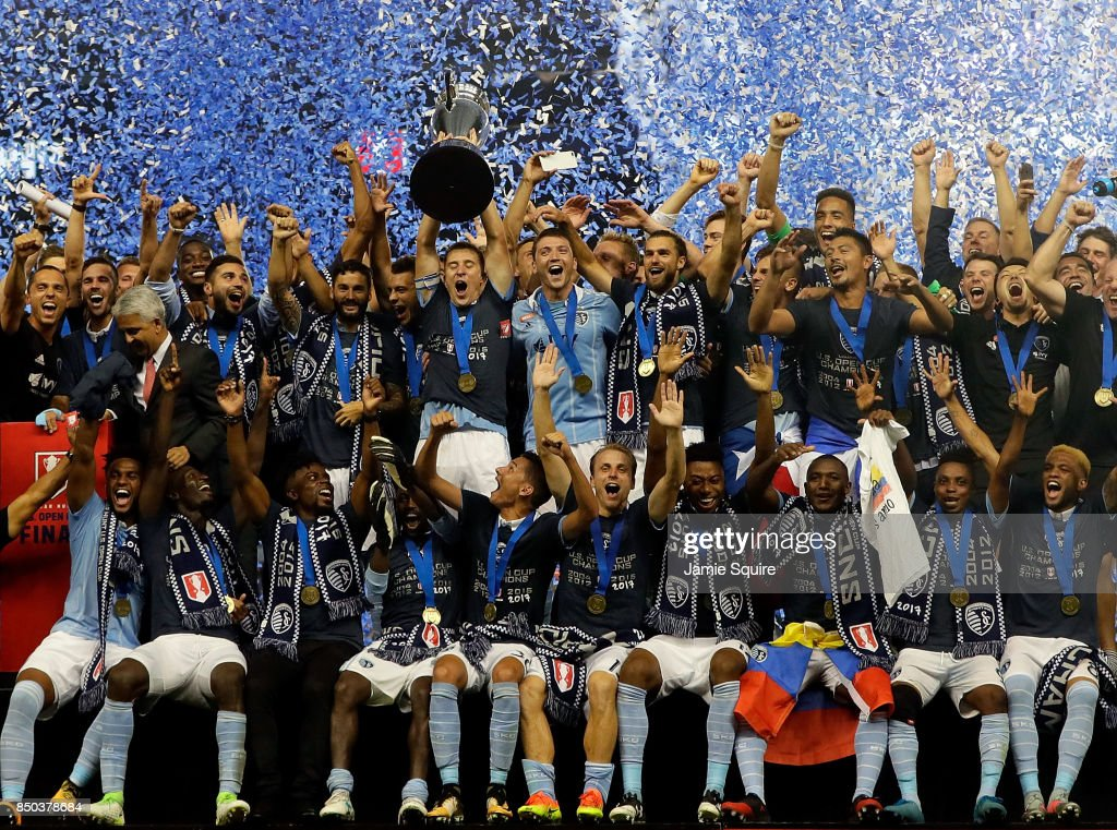 Sporting Kansas City celebrate with the trophy after they defeated New York Red Bulls 2-1 to win the 2017 U.S Open Cup Final at Children's Mercy Park on September 20, 2017 in Kansas City, Kansas.