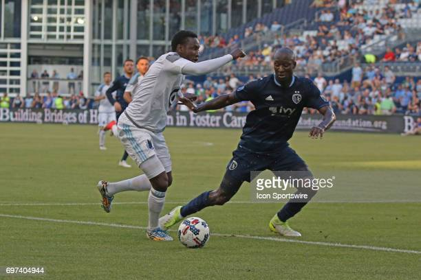 Sporting Kansas City defender Ike Opara marks up against Minnesota United forward Abu Danladi in the first half of a US Open Cup match between...
