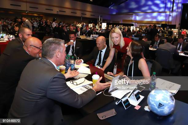 Sporting Kansas City draft table with Meghan Cameron league executive Amanda VandervortHays Brian Bliss Kerry Zavagnin Alec Dufty Zoran Savic and...
