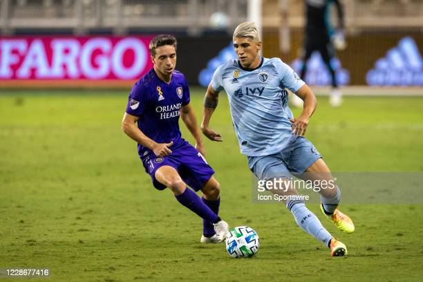 Sporting Kansas City forward Alan Pulido drives the ball during the second half against the Orlando City at Childrens Mercy Park in Kansas City,...