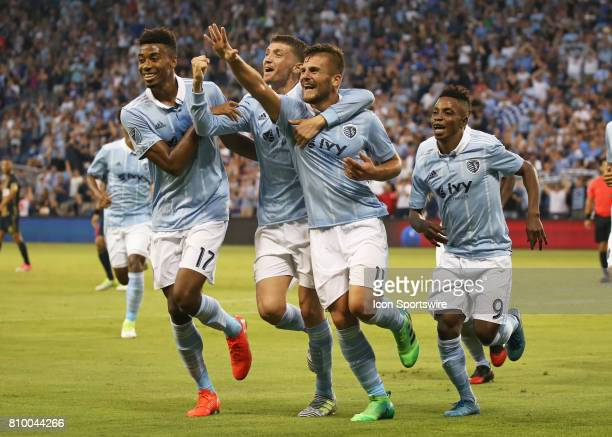 Sporting Kansas City forward Diego Rubio celebrates his second half goal with Ilie Sanchez Saad AbdulSalaam and Latif Blessing during an MLS match...