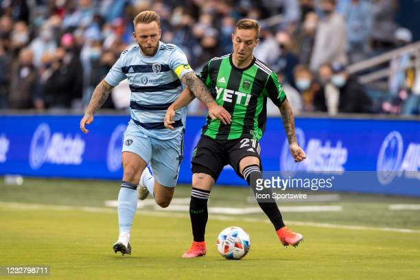 Sporting Kansas City forward Johnny Russell and Austin FC defender Zan Kolmanic go after the ball during the first half on May 9th, 2021 at Childrens...