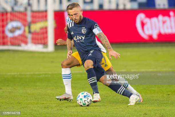 Sporting Kansas City forward Johnny Russell attempts to maneuver past a defender during the MLS playoff match between Sporting Kansas City and the...