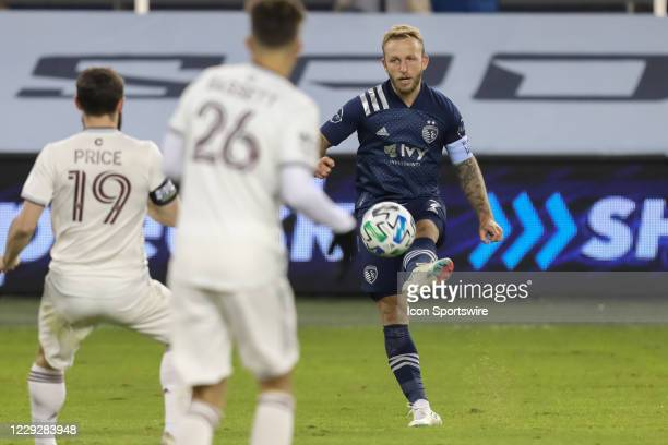 Sporting Kansas City forward Johnny Russell centers the ball in the second half of an MLS match between the Colorado Rapids and Sporting Kansas City...