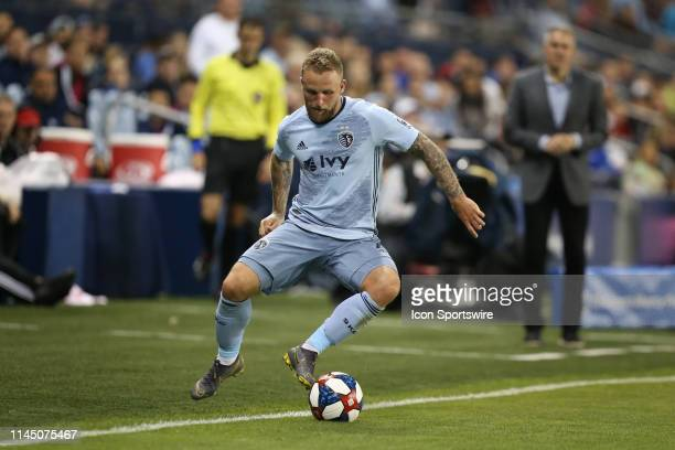 Sporting Kansas City forward Johnny Russell controls a ball along the sidelines in the second half of an MLS match between the Vancouver Whitecaps...