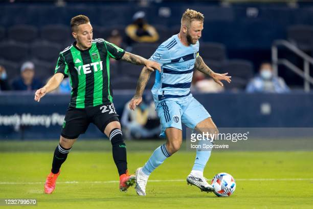 Sporting Kansas City forward Johnny Russell defends the ball agains Austin FC defender Zan Kolmanic during the second half on May 9th, 2021 at...