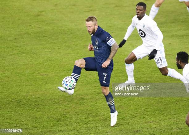Sporting Kansas City forward Johnny Russell handles a high pass in the first half of the MLS Western Conference Semifinal between Minnesota United FC...
