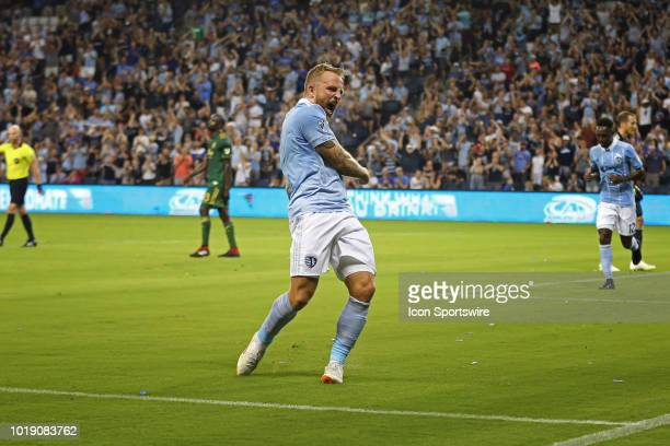 Sporting Kansas City forward Johnny Russell lets out a big yell after scoring a goal in the second half of an MLS match between the Portland Timbers...
