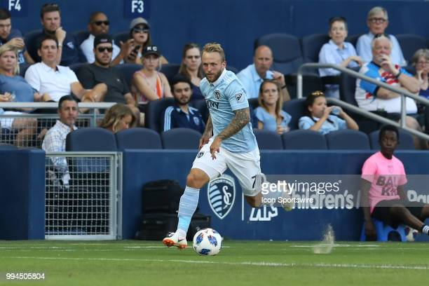 Sporting Kansas City forward Johnny Russell makes a run along the sideline in the first half of an MLS match between Toronto FC and Sporting Kansas...