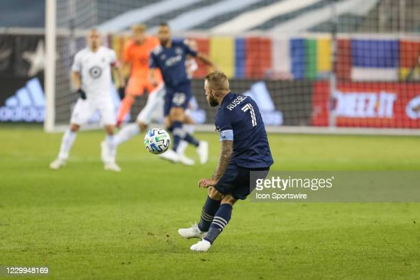 Sporting Kansas City forward Johnny Russell sends a free kick down the field in the second half of the MLS Western Conference Semifinal between...