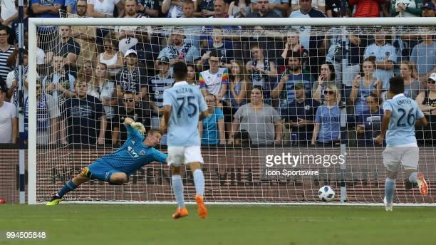 Sporting Kansas City goalkeeper Tim Melia can't reach a shot by Toronto FC midfielder Jonathan Osorio in the first half of an MLS match between...