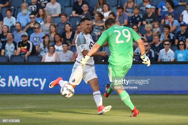 Sporting Kansas City goalkeeper Tim Melia clears the ball just in time in front of Minnesota United forward Bashkim Kadrii in the first half of a US...