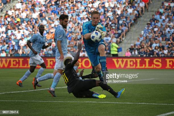 Sporting Kansas City goalkeeper Tim Melia comes off his line to make a save against Columbus Crew forward Gyasi Zerdes in the first half of an MLS...