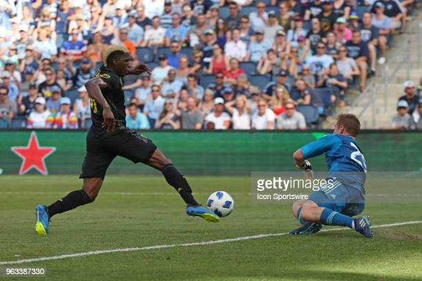 Sporting Kansas City goalkeeper Tim Melia comes off his line to defend Columbus Crew forward Gyasi Zerdes in the first half of an MLS match between...