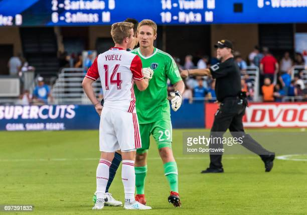 Sporting Kansas City goalkeeper Tim Melia congratulates San Jose Earthquakes midfielder Jackson Yueill for his debut performance during the regular...