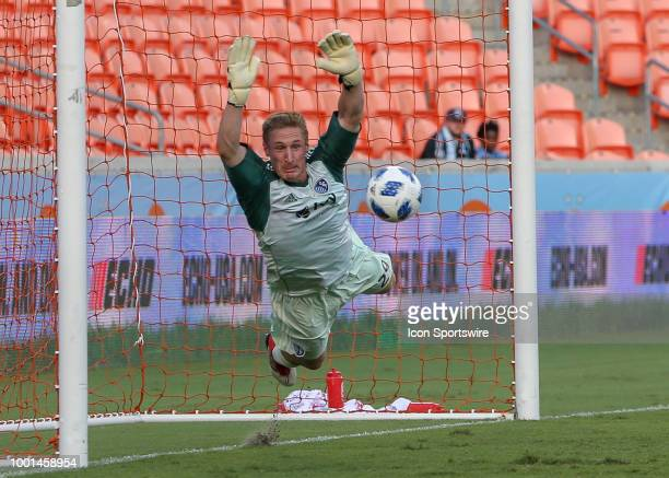 Sporting Kansas City goalkeeper Tim Melia dives to make a save during the US Open Cup Quarterfinal soccer match between Sporting KC and Houston...
