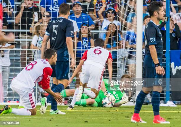 Sporting Kansas City goalkeeper Tim Melia holds the ball down out of the goal during the regular season match between the Sporting Kansas City and...