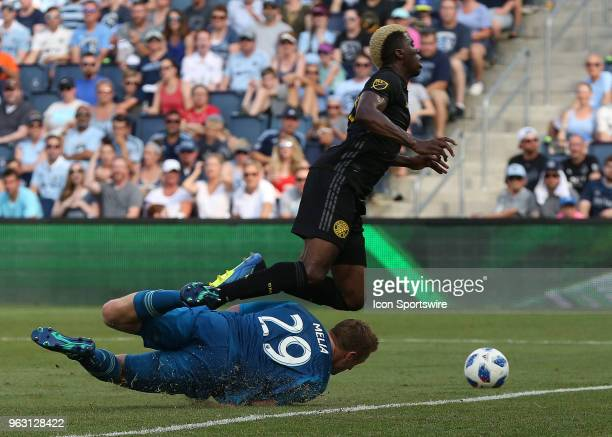 Sporting Kansas City goalkeeper Tim Melia is called for a foul in the box against Columbus Crew forward Gyasi Zerdes in the first half of an MLS...