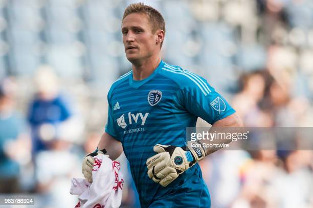 Sporting Kansas City goalkeeper Tim Melia jogs to his position during the MLS regular season match between Sporting Kansas City and the Columbus Crew...