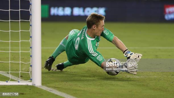 Sporting Kansas City goalkeeper Tim Melia makes a critical save on the first penalty shot during the Lamar Hunt US Open Cup semifinal between the San...