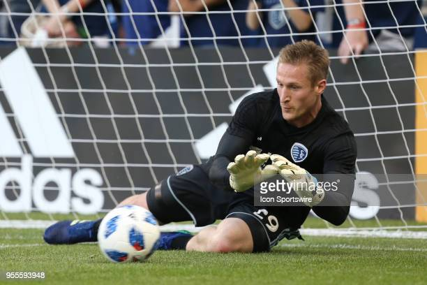 Sporting Kansas City goalkeeper Tim Melia makes a diving save in warmups before an MLS match between the Colorado Rapids and Sporting Kansas City on...
