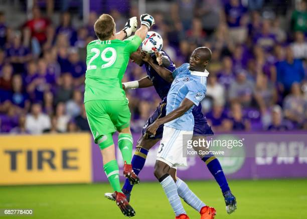 Sporting Kansas City goalkeeper Tim Melia makes a punch out save on Orlando City SC forward Cyle Larin header During the MLS soccer match between the...
