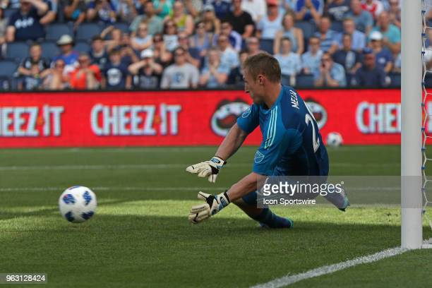 Sporting Kansas City goalkeeper Tim Melia makes the save on a penalty kick from Columbus Crew forward Gyasi Zerdes in the first half of an MLS match...