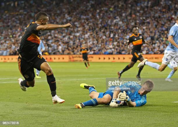 Sporting Kansas City goalkeeper Tim Melia stops a point blank range shot from Houston Dynamo forward Mauro Manotas in the second half of an MLS match...