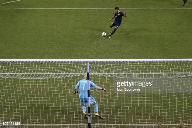 Sporting Kansas City midfielder Benny Feilhaber beats Atlanta United goalkeeper Brad Guzan on a penalty kick in the second half of an MLS match...