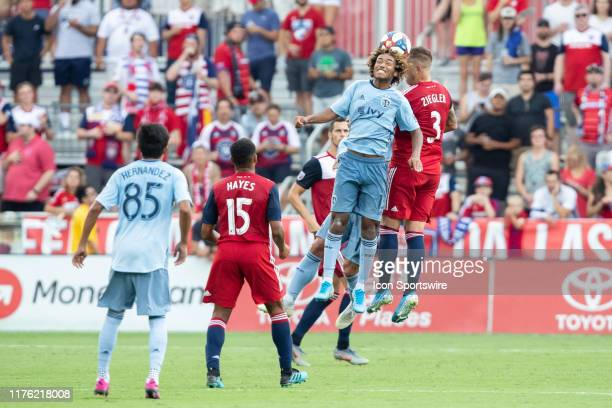 Sporting Kansas City midfielder Gianluca Busio and FC Dallas defender Reto Ziegler gol up for a header during the MLS soccer game between FC Dallas...