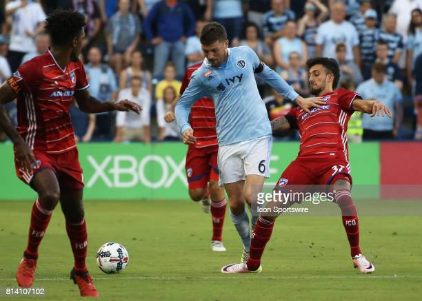 Sporting Kansas City midfielder Ilie Sanchez pushes off on FC Dallas forward Maximiliano Urruti in the first half of the US Open Cup quarterfinal...