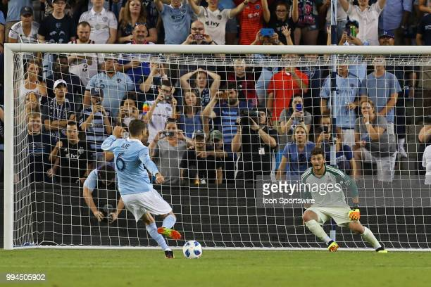 Sporting Kansas City midfielder Ilie Sanchez scores against Toronto FC goalkeeper Alex Bono on a penalty kick in the second half of an MLS match...