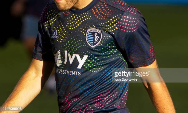 Sporting Kansas City midfielder Kelyn Rowe along with dons a specialized warm up shirt for Pride week prior to the match between Sporting Kansas City...