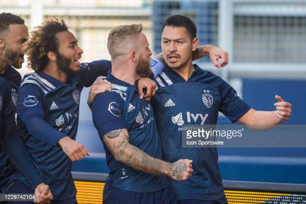 Sporting Kansas City midfielder Roger Espinoza celebrates with teammates after scoring the opening goal during the MLS playoff match between Sporting...