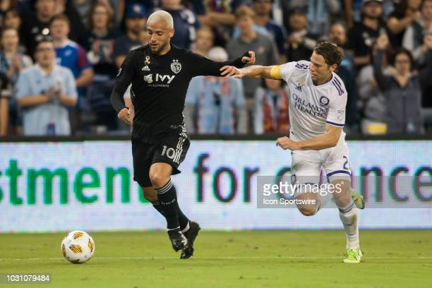 Sporting Kansas City midfielder Yohan Croizet shields off Orlando City defender Jonathan Spector during the match between Sporting Kansas City and...