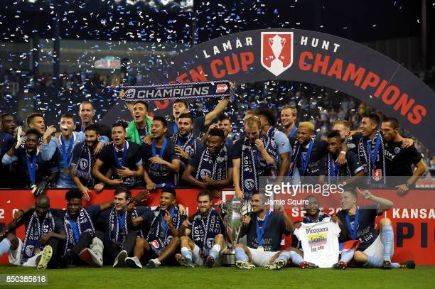 Sporting Kansas City players celebrate with the trophy after defeating the New York Red Bulls 21 to win the 2017 US Open Cup Final at Children's...