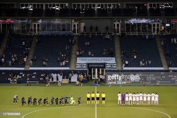 Sporting Kansas City players kneel during the National Anthem prior to the game against the Chicago Fire at Children's Mercy Park on October 07, 2020...